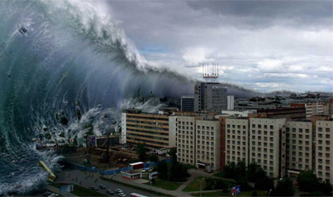 Tấm ảnh về động đất, sóng thần gây kinh hoàng khắp thế giới, những con sóng lớn liên tục đổ ập vào thành phố và người dân không còn đường nào mà chạy. (Ảnh: Gettyimages)